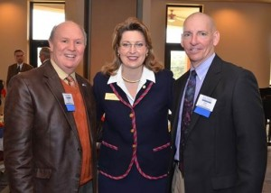 Lisa McWherter, Southern Wesleyan University's vice president for advancement, is pictured with S.C. Sen. Thomas Alexander, left, and Central Town Administrator Phillip Mishoe, right, during the 2015 Legislative Appreciation Luncheon, held Feb. 23 at the university's campus in Central.