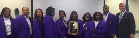 SC CHE Chair Tim Hofferth (far right) presents Benedict College SLLD Team with 2016 Service Learning Award.