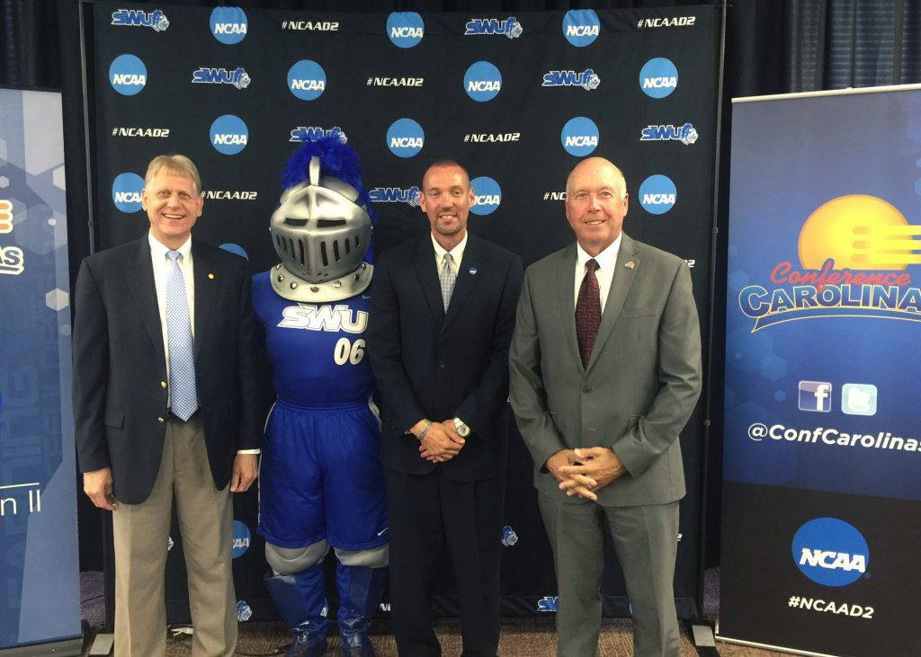 (L-R) Dr. Todd Voss, SWU president; SWU Warrior mascot, Chris Williams SWU director of athletics; Dr. Alan Patterson, Conference Carolinas commissioner.