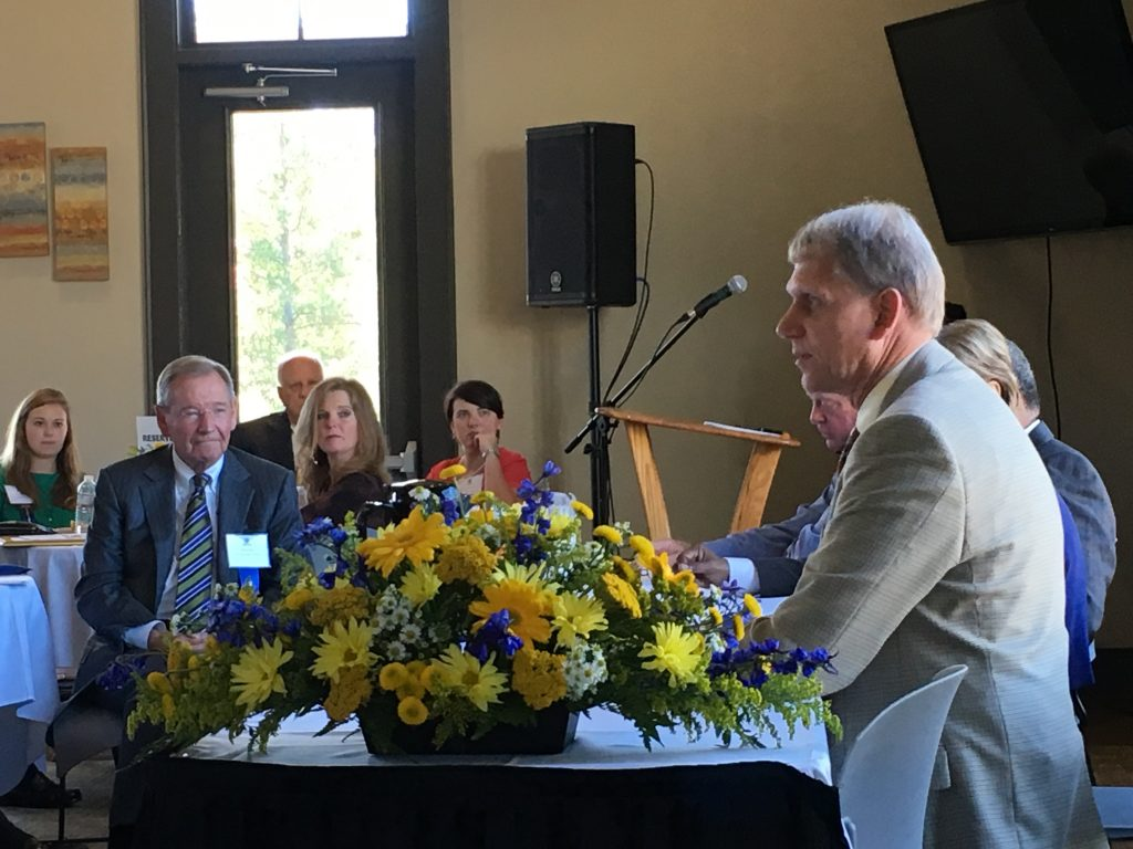 Dr. Todd Voss (pictured in foreground), president of Southern Wesleyan University, leads the Presidents' Panel Discussion.