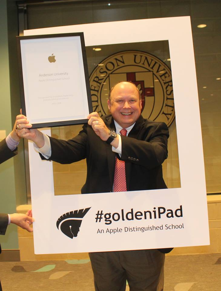 Dr. Evans Whitaker, President, accepting Apple Distinguished School Award on behalf of Anderson University.