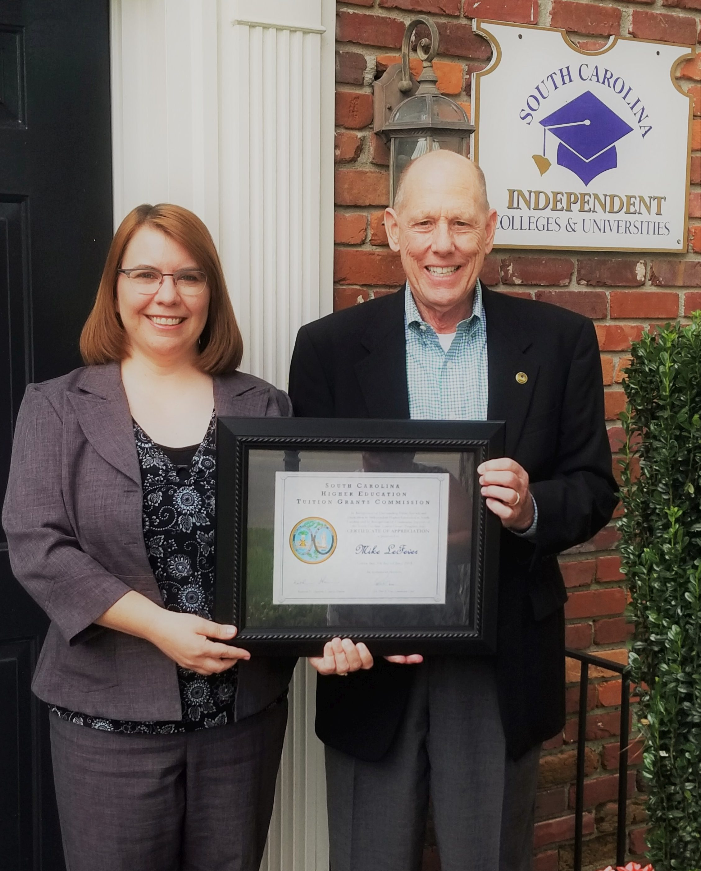 Katie Harrison, Executive Director of the SC Tuition Grants Commission, presented a Certificate of Appreciation to SCICU President and CEO Mike LeFever at the commission's June board meeting.